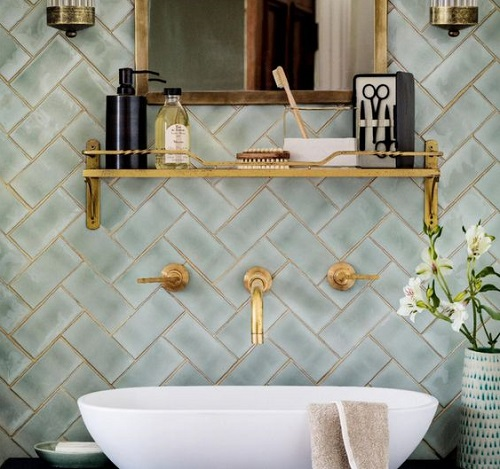 brass bathroom accessories green tiles
